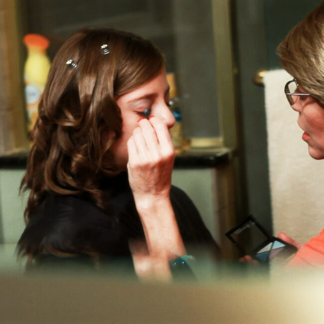 Naomi Kutin gets make-up before her Bat Mitzvah, in Supergirl