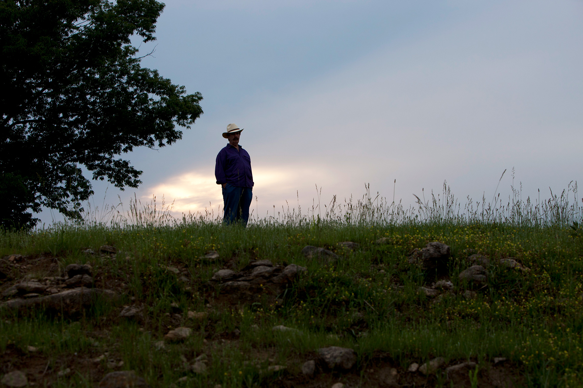 Rick Hall stands on a hillside in Muscle Shoals.
