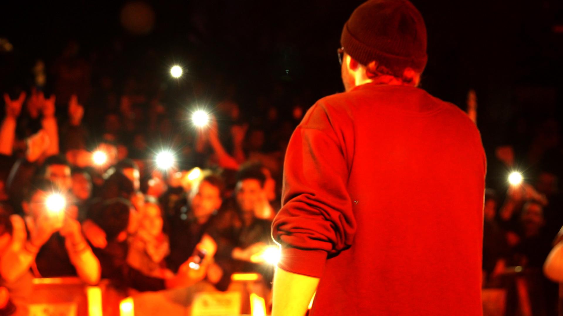 Shahin Najafi in a public performance, from When God Sleeps