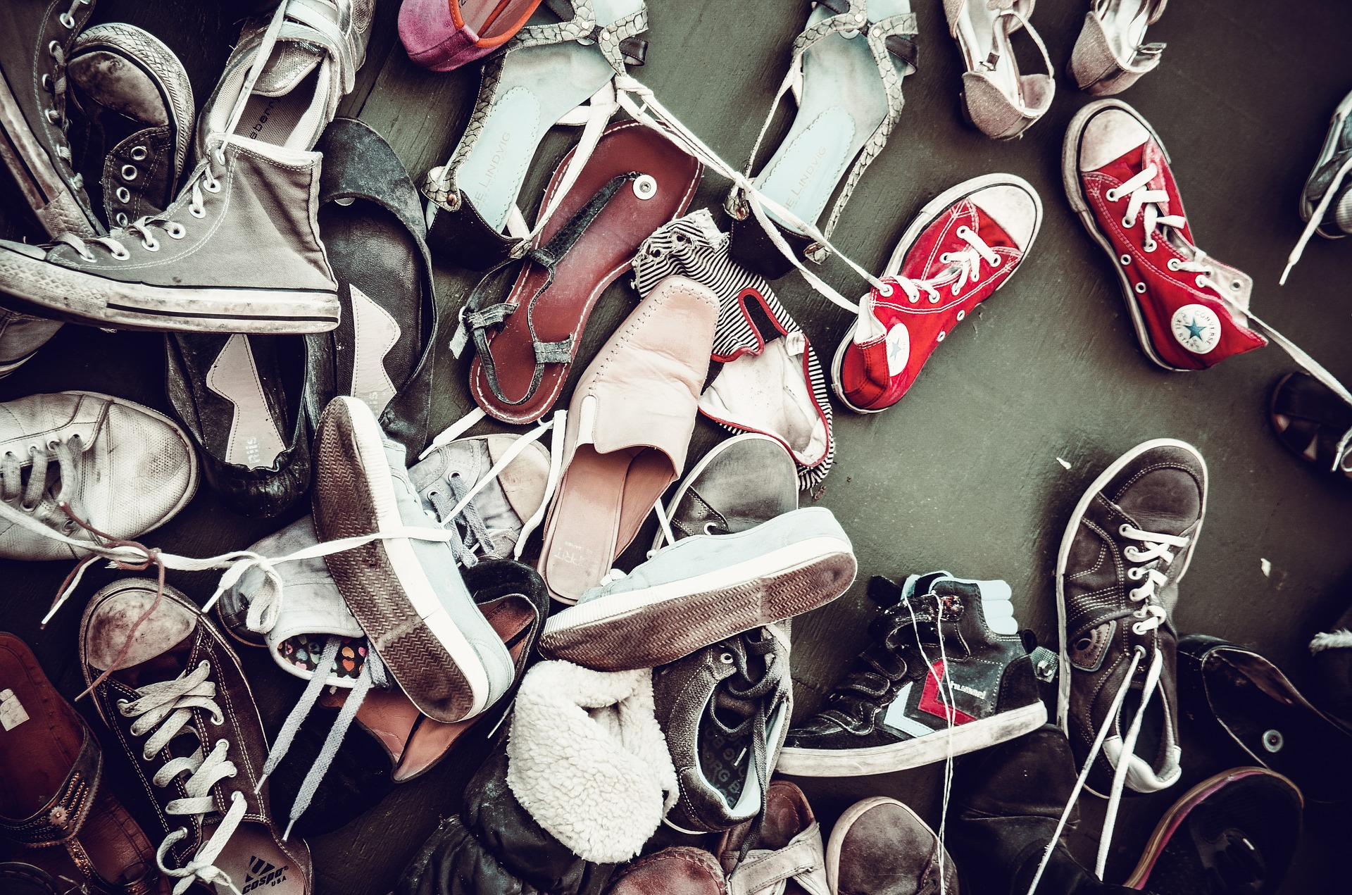 a big pile of worn sneakers, free image courtesy of Pixabay