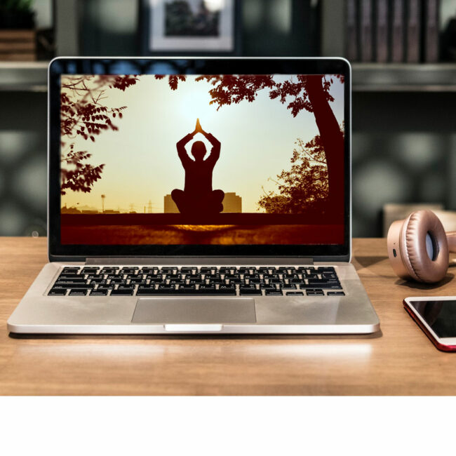 Woman meditating and doing yoga on a laptop screen, images courtesy Pexels.com