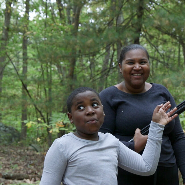 Dasan and his mother out in the woods, from Tre Maison Dasan