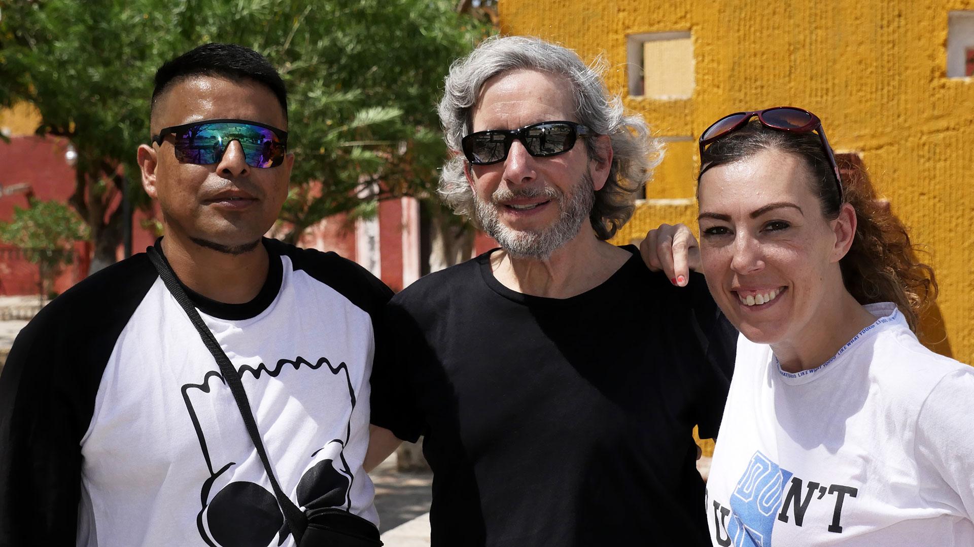 Filmmaker David Sutherland (center) with Marcos and Elizabeth