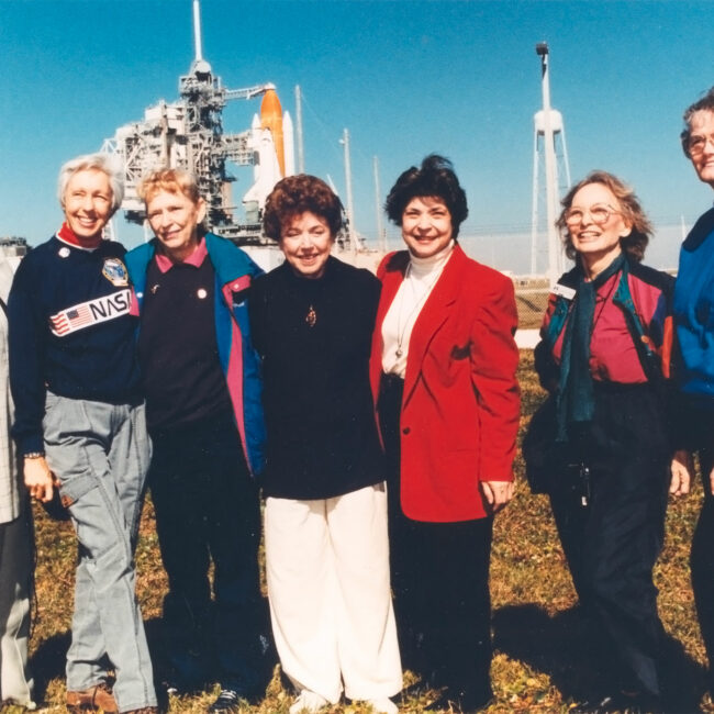 At the Kennedy Space Center, seven women who once aspired to fly into space stand outside Launch Pad 39B neat the Space Shuttle Discovery, poised for liftoff on the first flight of 1995. They are members of the First Lady Astronaut Trainees (FLATs, also known as the