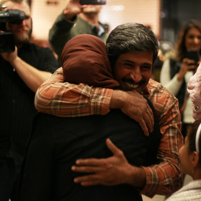 Phillip Morris hugs his wife when reunited at Minneapolis airport.