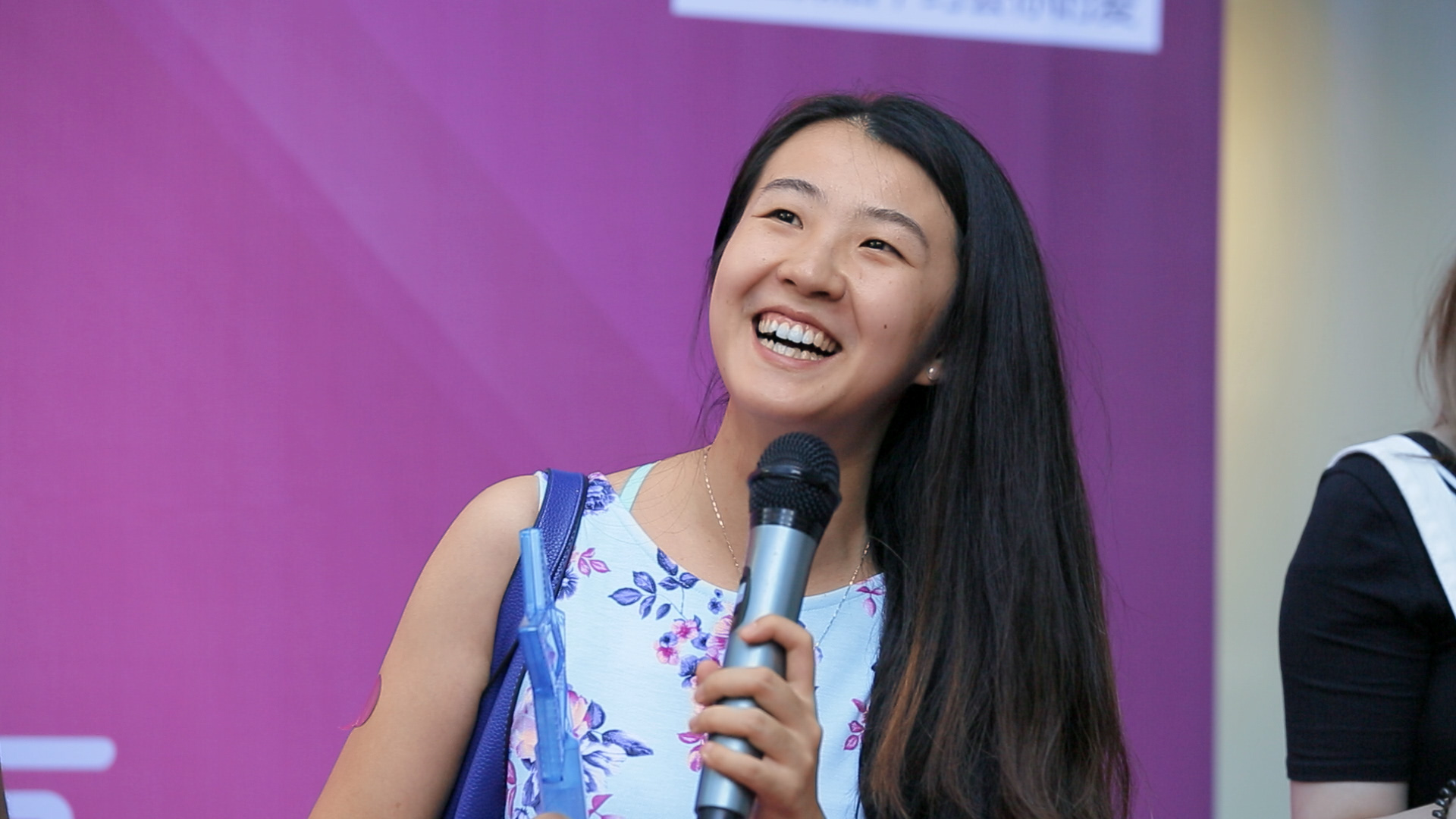 Xu Min, from Leftover Women, speaks to single men at a matchmaker event in China