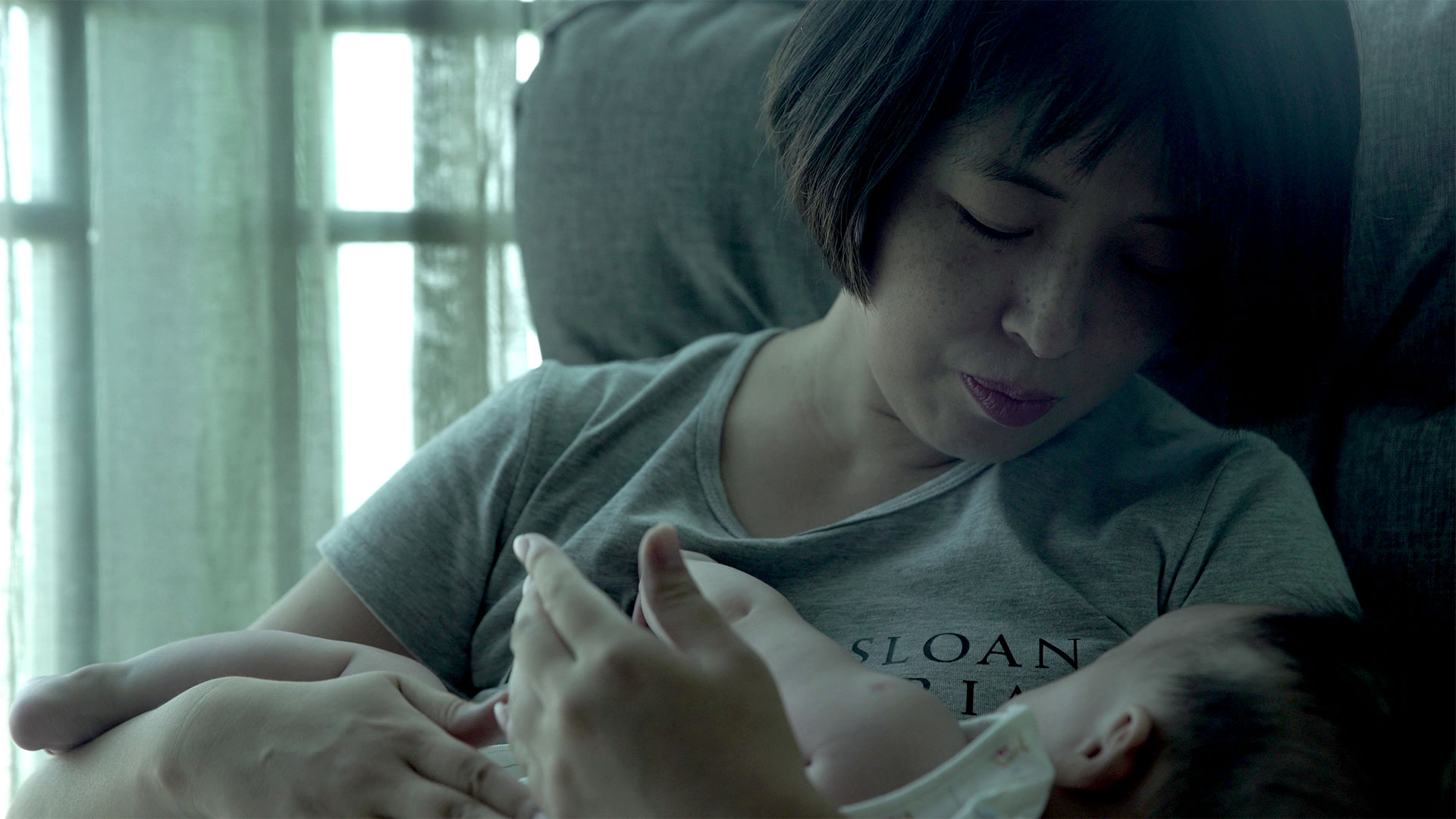 GAI QI and her baby, in Leftover Women