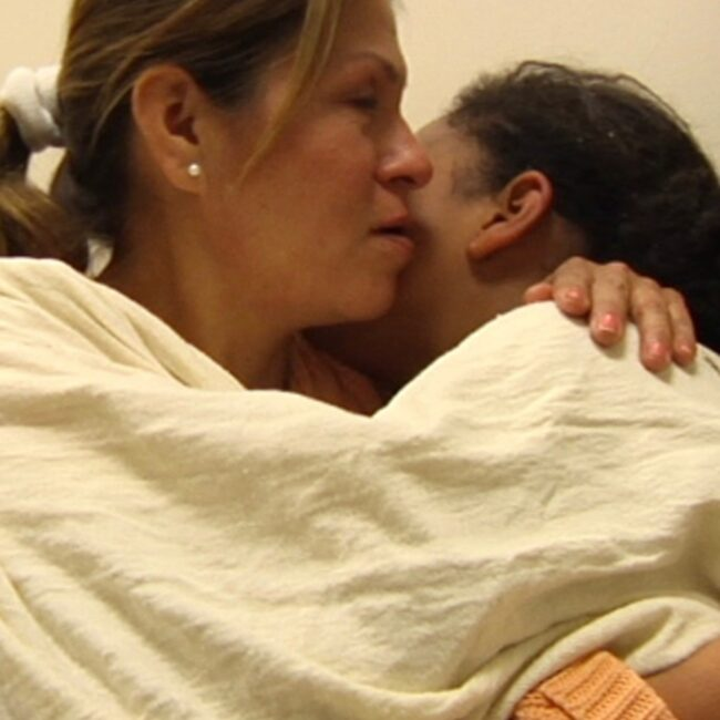 mother and daughter hugging in hospital