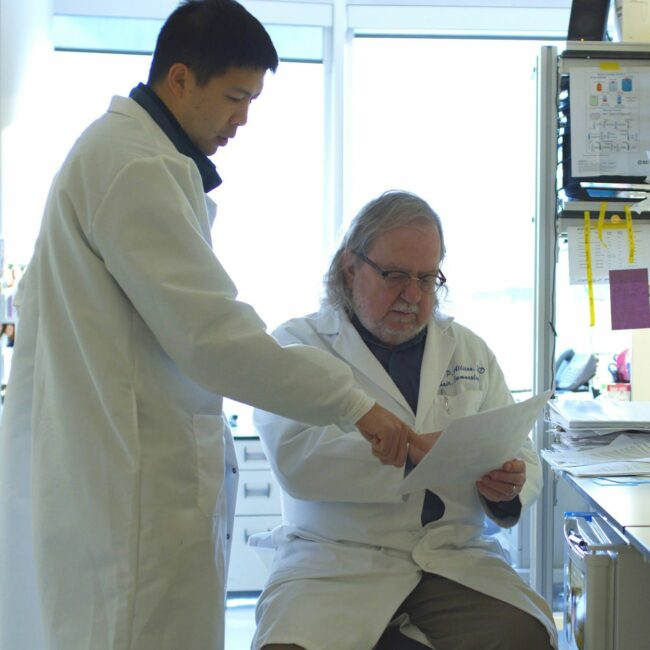 Jim Allison and colleague in lab coats