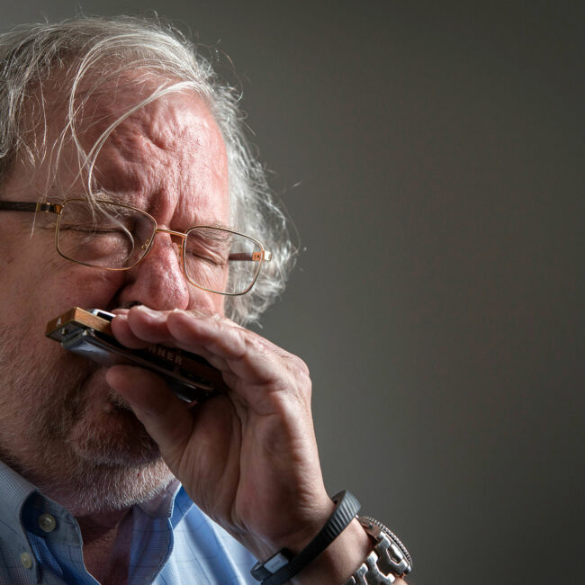 Cancer researcher Jim Allison playing his blues harmonica