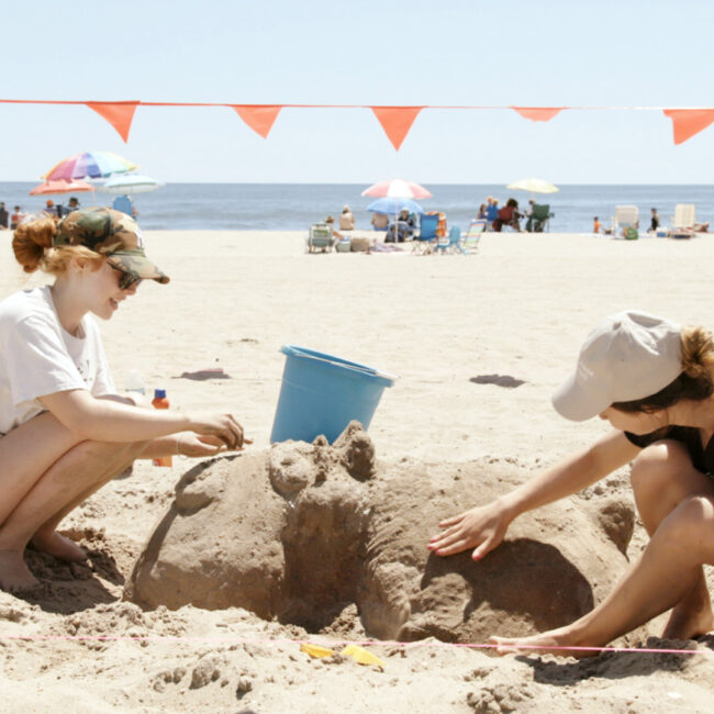 Sandcastle building on beach in New York