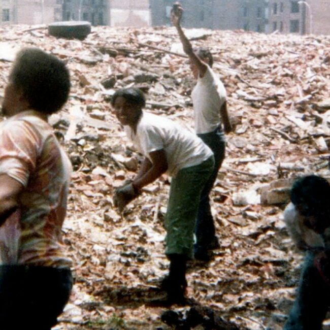 Members of community clear rubble in the Bronx, in Decade of Fire.