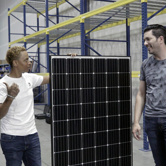 Jonathan Scott at a solar company in Nevada, with solar panel