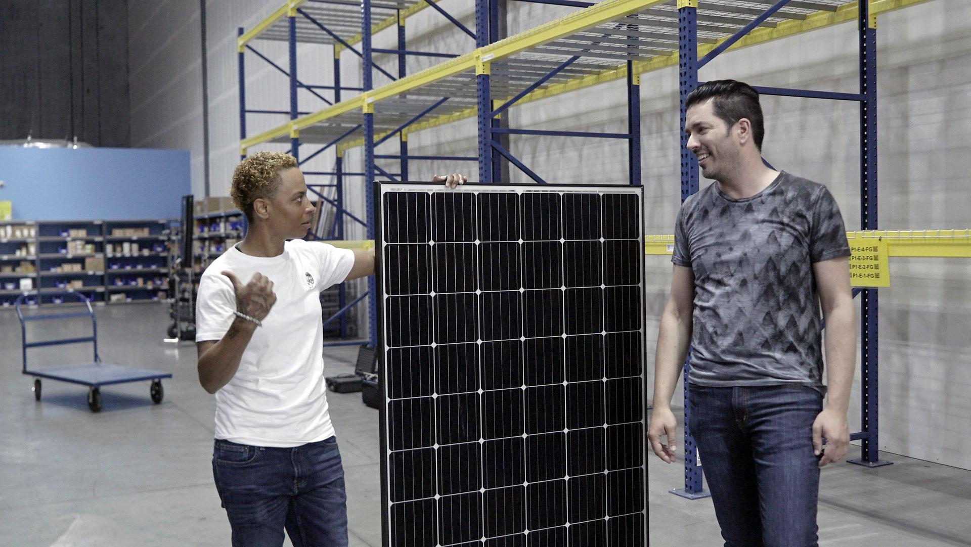 Jonathan Scott at a solar company in Nevada, with solar panel