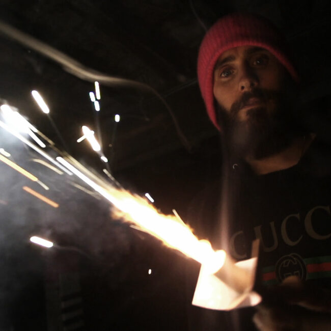 Jared Leto working on his film carrying a blow torch