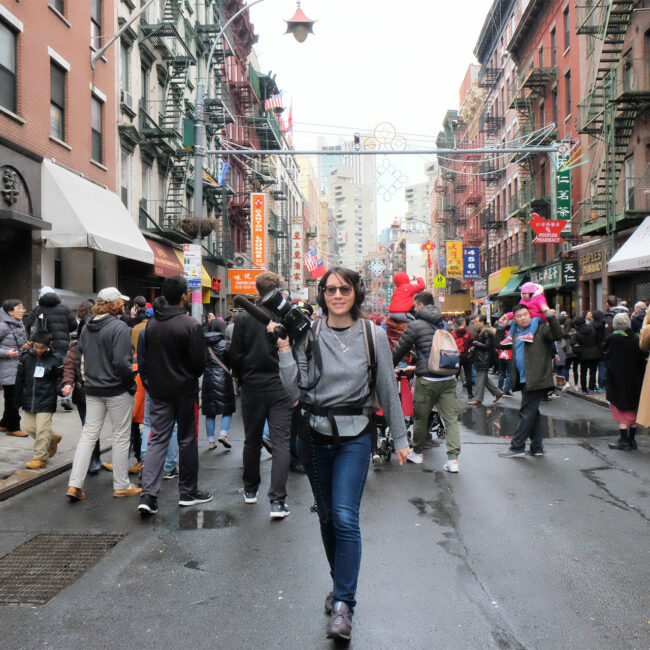 Filmmaker Ursula Liang with camera on location in New York
