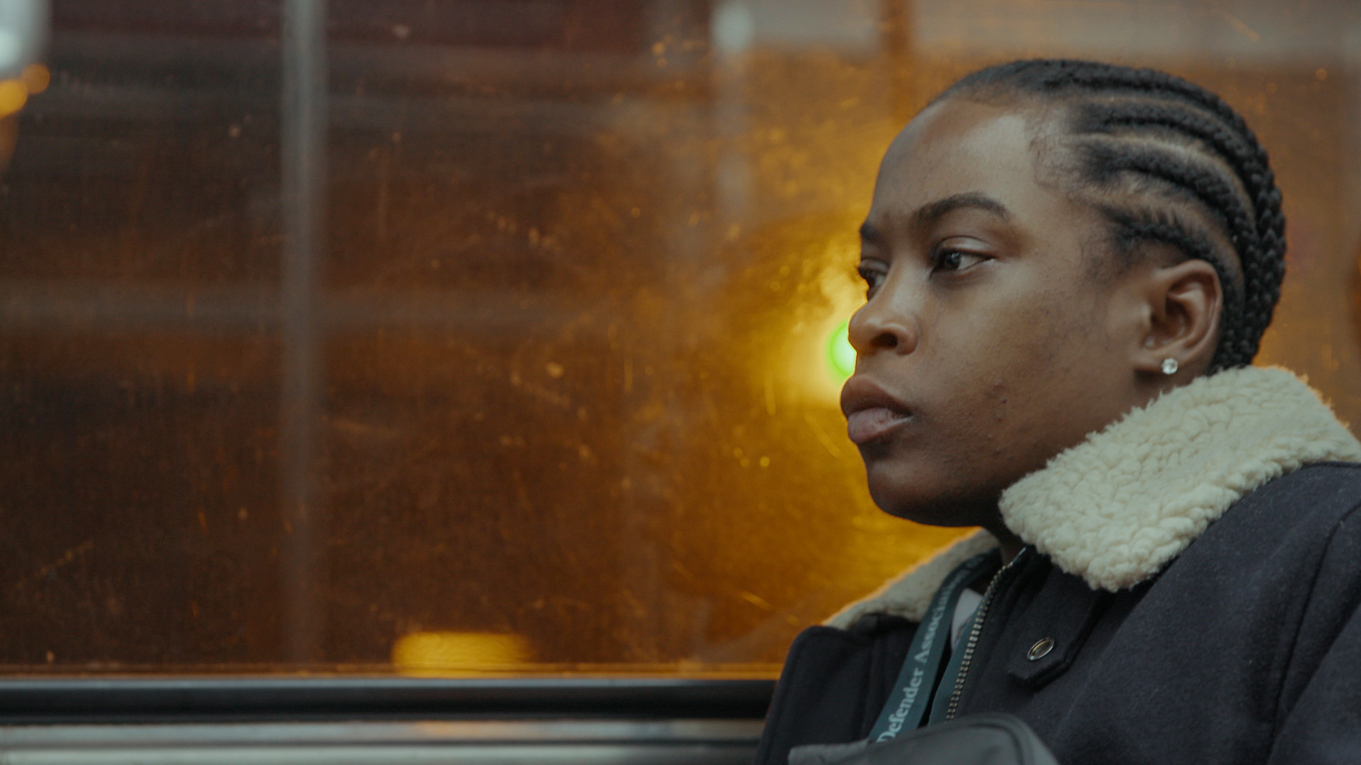LaTonya Myers riding public transport while lost in thought, in Philly D.A.