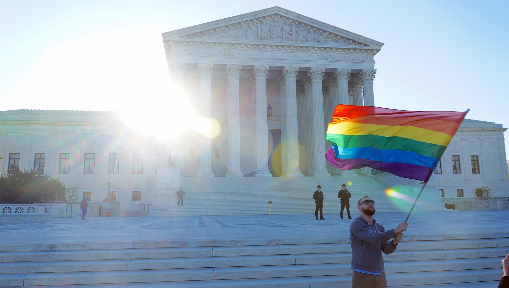 Photo taken at steps of Supreme Court, 2015, on Gay Marriage decision. Man carrying Pride flag.