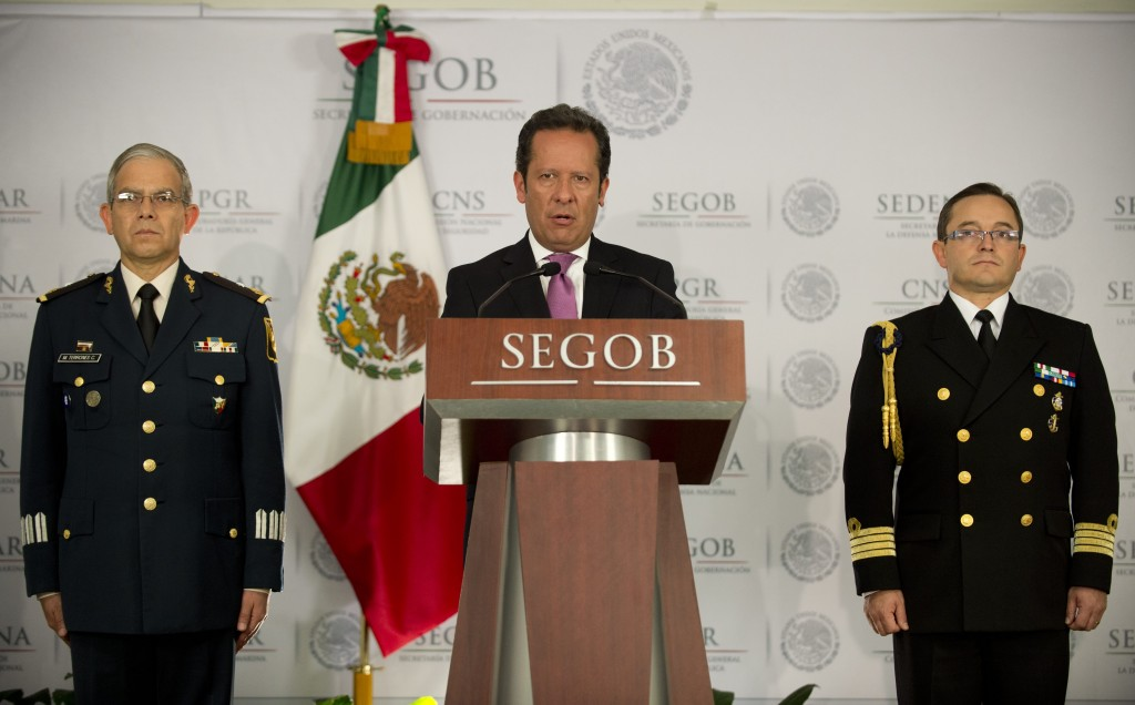 Mexican government security spokesman Eduardo Sanchez (C) speaks during a press conference, accompanied by Mexican Navy General Jorge Victor (L) and Mexican Army General Martin Terrones (R) to present details of the military operation in which Miguel Angel Trevino Morales, the alleged drug lord behind the cartel Los Zetas, was arrested. Photo by Yuri Cortez/AFP/Getty Images