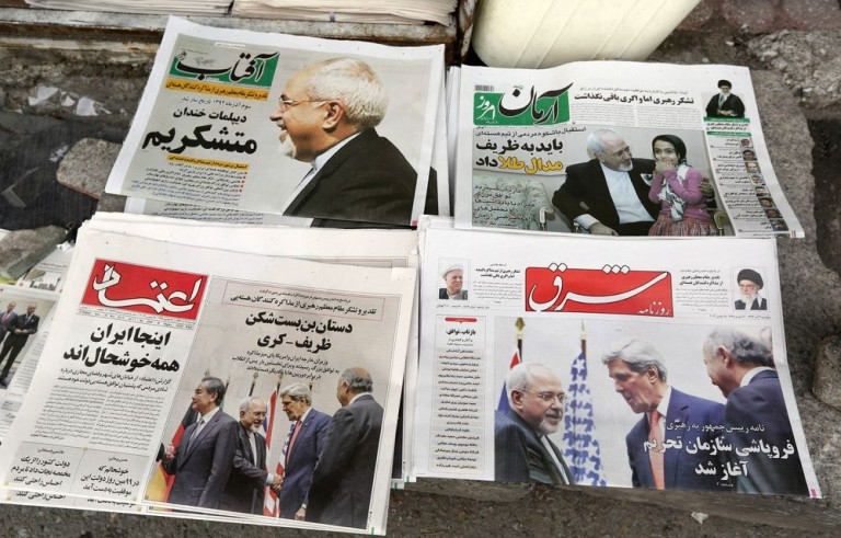 Iranians newspapers headlining the deal made with major powers over Iran's disputed nuclear deal are displayed on the ground outside a kiosk in Tehran on November 25, 2013. Most Iranian newspapers hailed the historic deal, attributing the relatively swift success to Foreign Minister Mohammad Javad Zarif (top left).  AFP PHOTO/ATTA KENARE        (Photo credit should read ATTA KENARE/AFP/Getty Images)