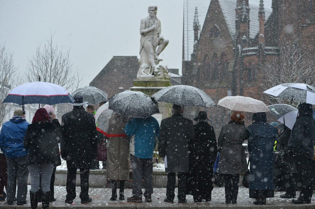 In snowy Dumfries, Scotland, people gather around a statue of the national poet, Robert Burns, on January 25, the anniversary of his birth. Photo by Jeff J Mitchell/Getty Images