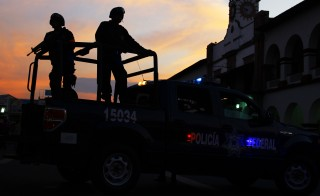 Mexican federal police patrol during a march for peace in Apatzingan, Michoacan state, Mexico, on Jan. 18, 2014. Photo by Hector Guerrero/AFP/Getty Images.