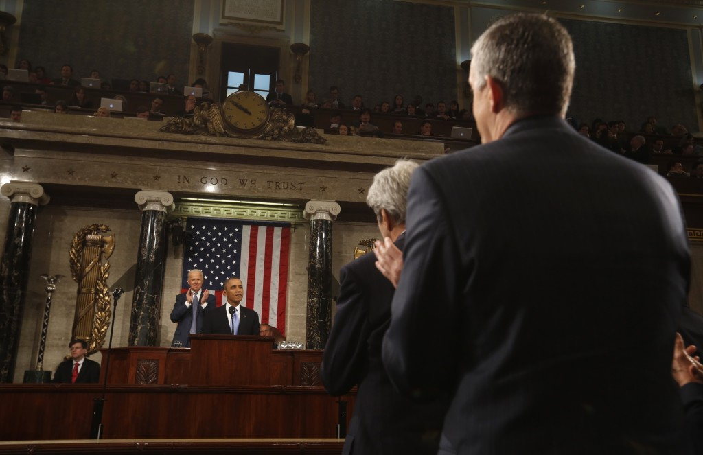 Lawmakers watch President Obama deliver his 5th State of the Union Address on Jan. 28, 2014.