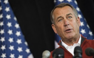 Speaker of the House John Boehner spoke to the press on Friday, announcing the House GOP's lawsuit against parts of the Obama administration's Affordable Care Act, adding that the president has overstepped his executive authority. Photo by Jim Watson AFP/Getty Images.