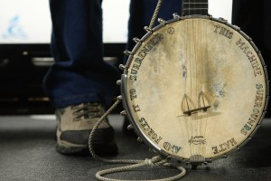"Pete Seeger's banjo is famously inscribed with the words ""This machine surrounds hate and forces it to surrender."" Photo by Neilson Barnard/Getty Images"