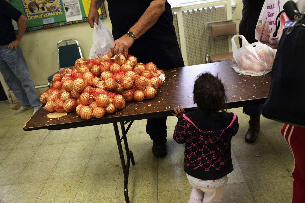 The solution to economic inequality depends on what you think the cause is. Photo of the Central Park United Methodist Church weekly food pantry in Reading, Penn., by Spencer Platt/Getty Images