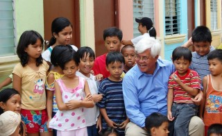 "Antonio ""Tony"" Meloto, founder of Gawad Kalinga, is seen here with children in the Pinagsama village in Taguig city, Philippines. Photo courtesy of Gawad Kalinga."