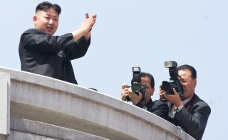 North Korean leader Kim Jong Un applauds during a military parade in honor of the 100th birthday of the late North Korean leader Kim Il Sung in Pyongyang on April 15, 2012. Photo by Ed Jones/AFP/Getty Images