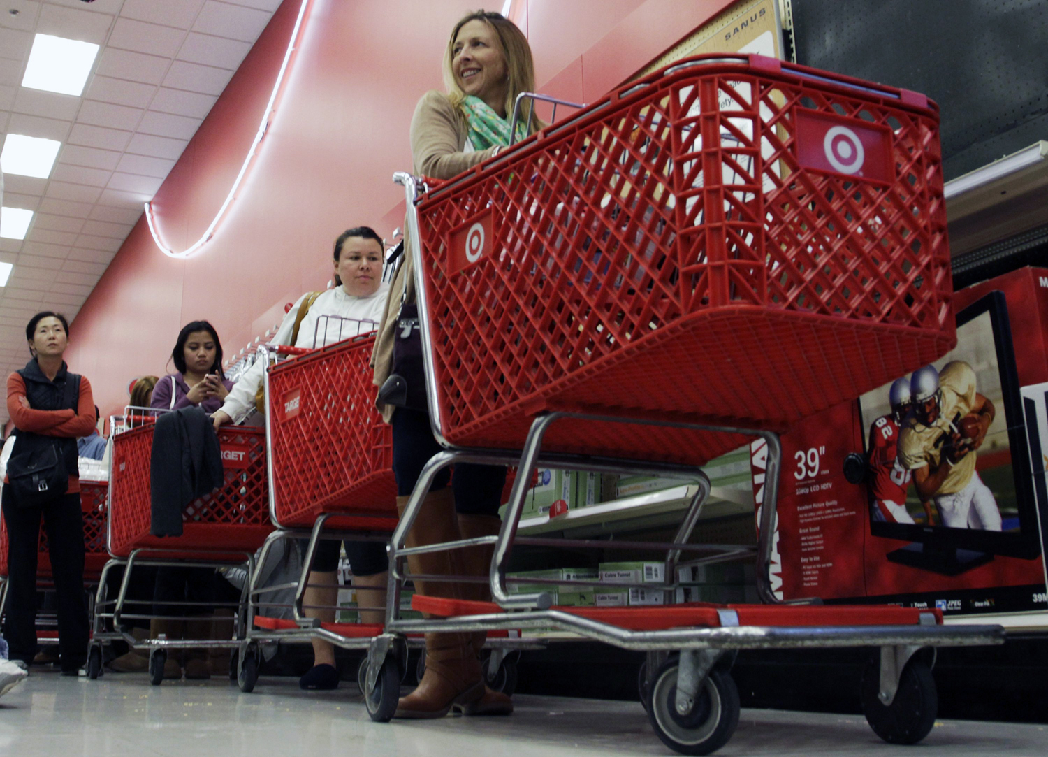 Shoppers wait in line at Target.