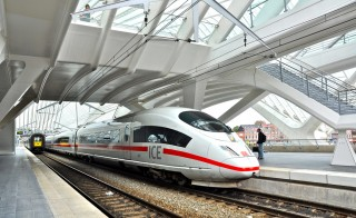 "Caption: German (Deutsche Bahn) high speed international express (ICE) running between Belgium and Germany on the Brussels Midi - Frankfurt (Main) Hbf service, stopping at the new Liège-Guillemins (Wallonia, Belgium) station in the Frankfurt direction. According to the Eurail website, ""With a maximum speed of 300 km/h (186 mph) these ICE high-speed trains connect major German cities at hourly intervals. Also, international ICE trains connect Germany with Austria (Wien, Innsbruck), Belgium (Brussels, Liège), Denmark (Copenhagen, Arhus), France (Paris), the Netherlands (Arnhem, Utrecht, Amsterdam) and Switzerland (Zürich, Interlaken)."" Although the trains are a German service and brand, ICE stands for 'Inter-City Express' in English."