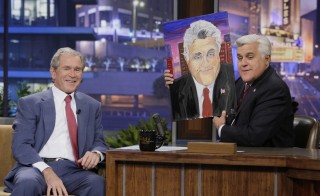 In an appearance on The Tonight Show, former President George W. Bush gifted Jay Leno with a portrait of the late night host. Photo by NBCU Photo Bank via Getty Images