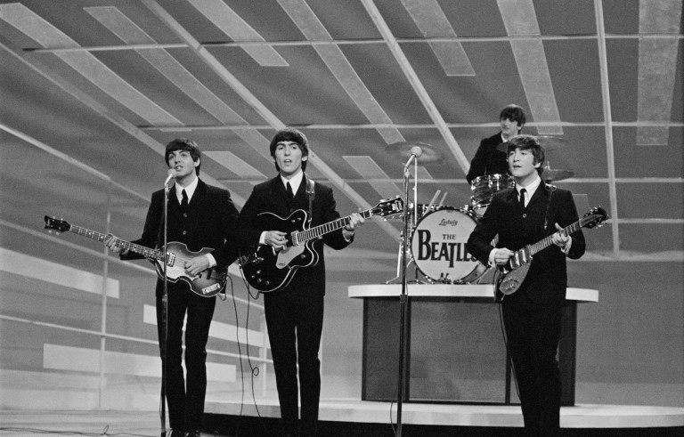 The Beatles perform during their first appearance on The Ed Sullivan Show, February 9, 1964. Photo by CBS/Getty Images