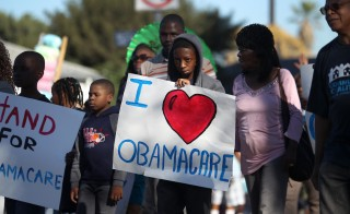 Supporters of the Affordable Care Act march in Los Angeles Jan. 20.  Photo by David McNew/Getty Images