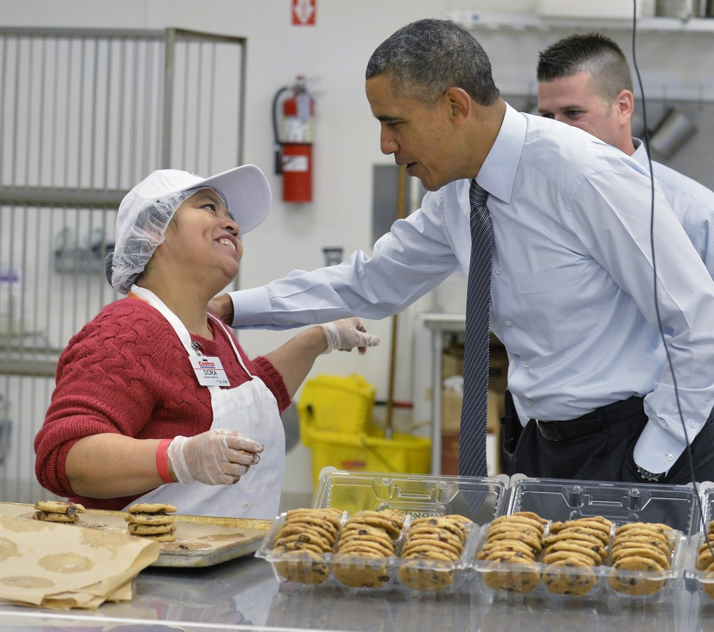 President Obama greets a Costco bakery employee January 29 in Lanham, Md. to promote raising the minimum wage. Photo by Mike Theiler-Pool/Getty Images