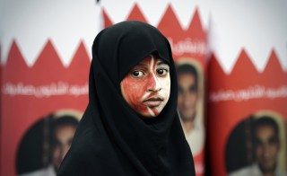 A Bahraini girl takes part in an anti-government protest in a village south of the capital in early February. Photo by Mohammed Al-Shaikh/Getty Images