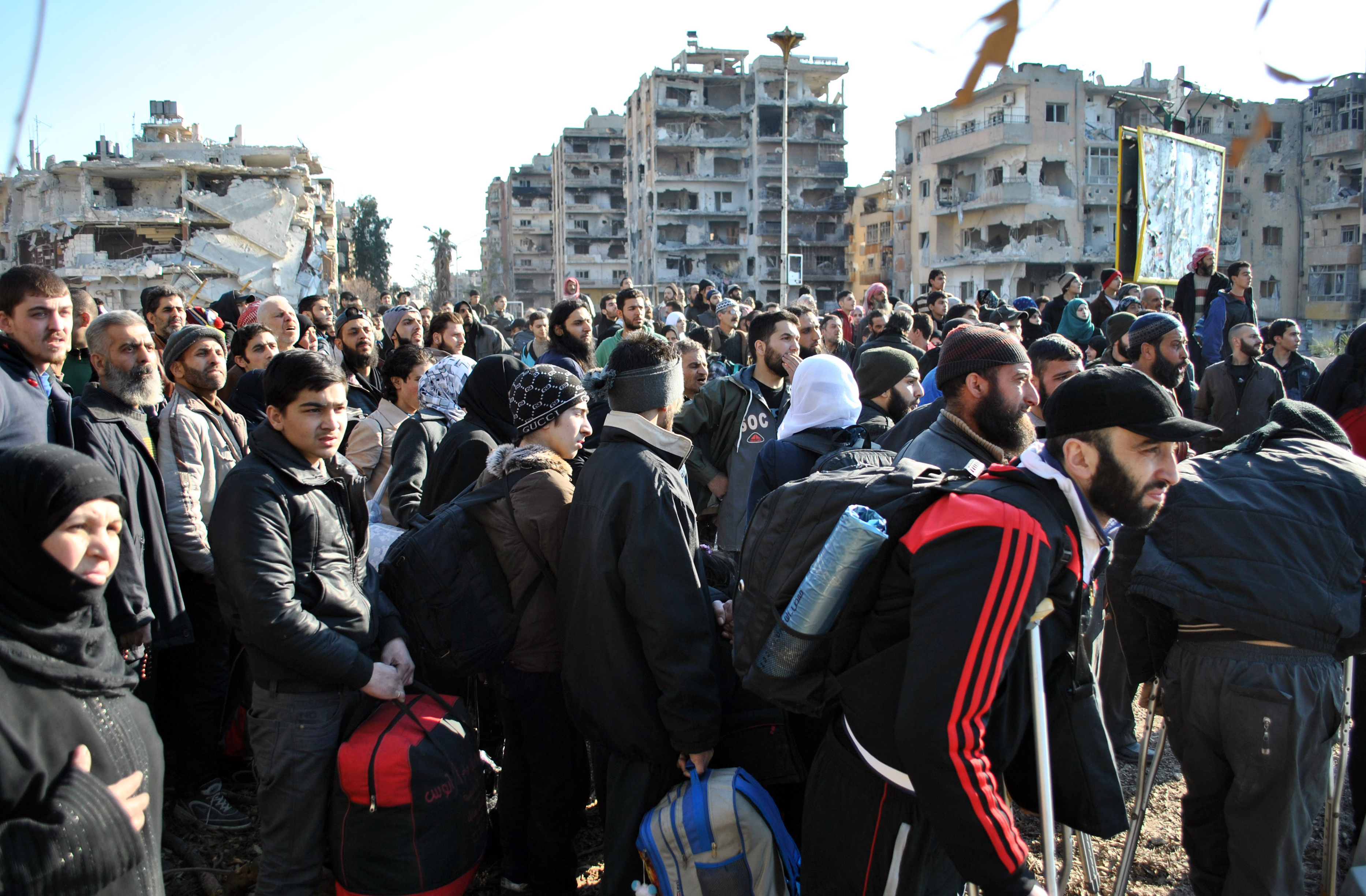 Civilians wait to be evacuated by United Nations staff from the central Syrian city of Homs on Feb. 9, 2014. Photo by Bassel Tawil/AFP/Getty Images