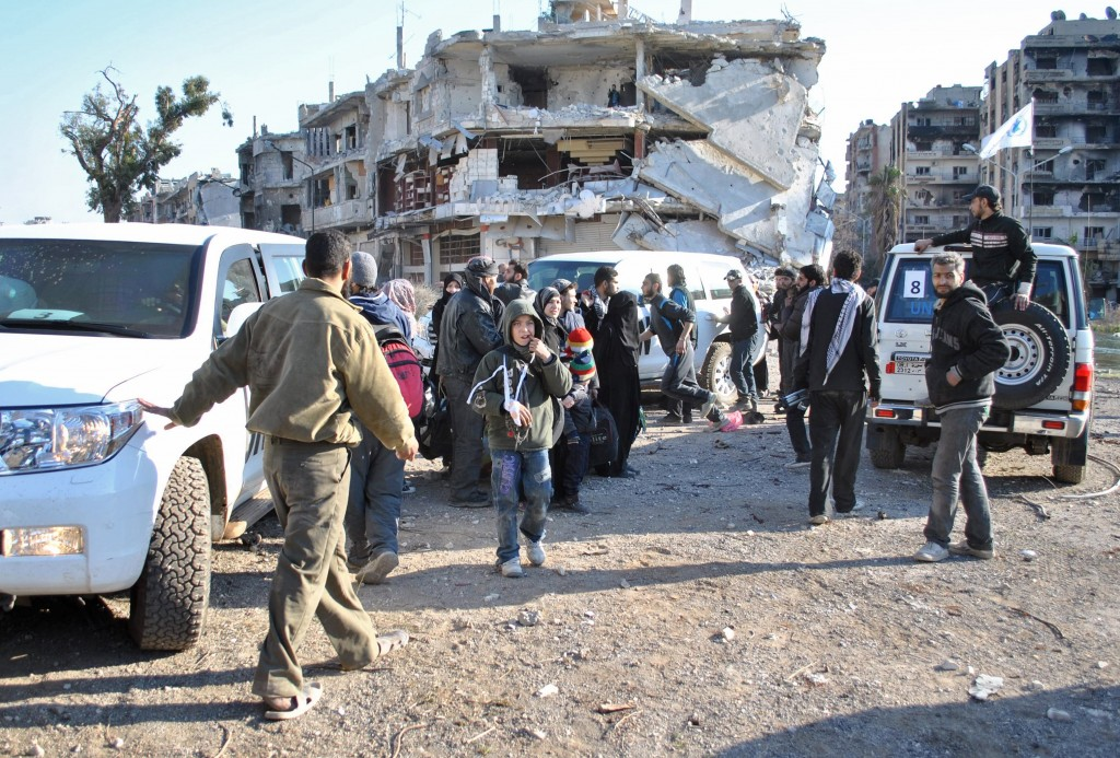 Civilians wait to be evacuated from the besieged district of the central Syrian city of Homs by United Nations staff on Feb. 9, 2014. Photo by Bassel Tawil/AFP/Getty Images