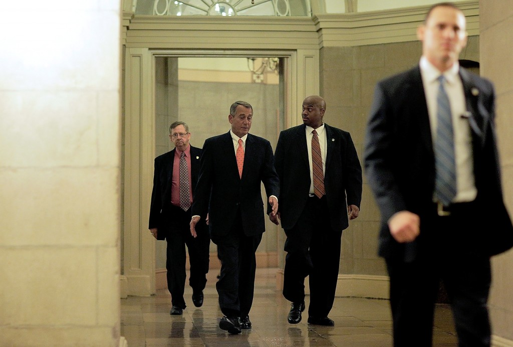 Speaker of the House John Boehner leaves the Capitol building on Tuesday after voting to pass an extension on the debt ceiling. Photo by T.J. Kirkpatrick/Getty Images