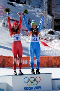 Switzerland's Dominique Gisin and Slovenia's Tina Maze share the gold medal in women's downhill skiing. Photo by Alain Grosclaude/Agence Zoom/Getty Images