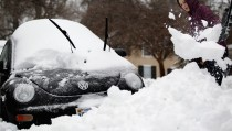 Grace Gordon digs her car out of snow February Thursday in Warrenton, Va. Most of the metropolitan Washington, D.C., area received almost a foot of snow this week. Photo by Alex Wong/Getty Images