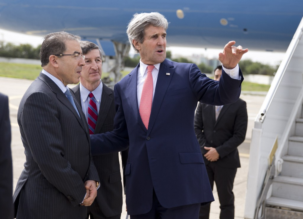 Secretary of State John Kerry, right, talks with Tunisian Foreign Minister Mongi Hamdi, left, and Ambassador Jake Walles after arriving in Tunis on Feb.18. Kerry promised American assistance Tuesday in the North African nation's battle against terrorists. Photo by Evan Vucci/AFP/Getty Images