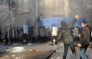 Anti-government protesters throw ripped-up cobblestones at police in in the center of Kiev on February 18, 2014.