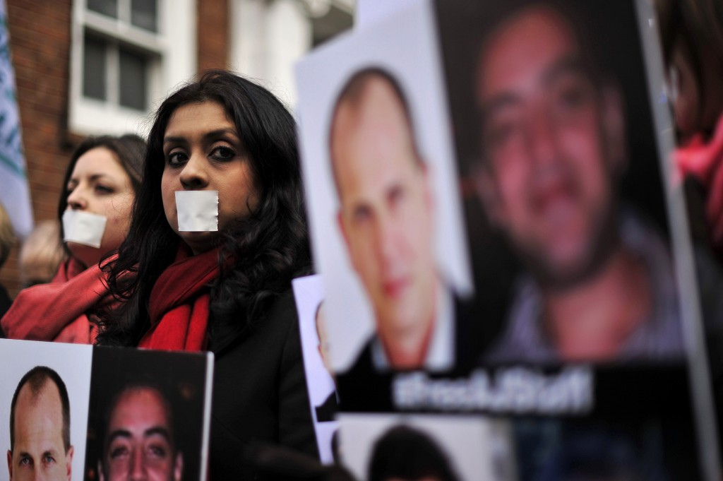 Demonstrators protest outside the Egyptian embassy in London Wednesday to demand the immediate release of detained journalists in Egypt. Photo by Carl Court/AFP/Getty Images
