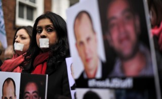 Demonstrators protest outside the Egyptian embassy in London Wednesday to demand the immediate release of detained journalists in Egypt on Feb. 19, 2014. Photo by Carl Court/AFP/Getty Images