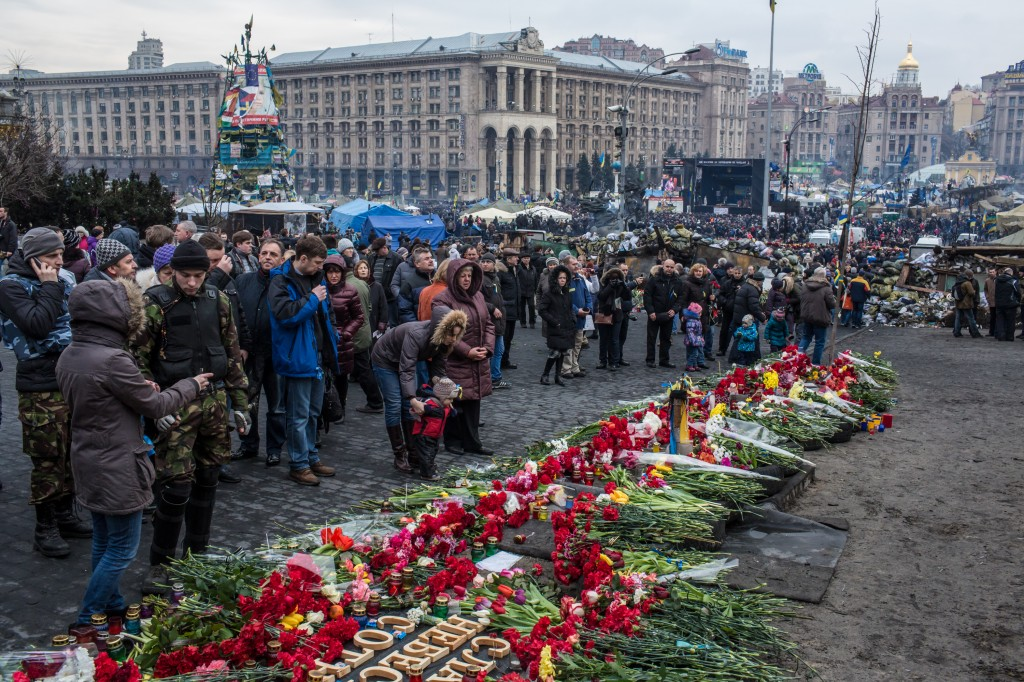 While parliament acts quickly to get interim government in place, demonstrators continue to gather and mourn victims in Kiev's Independence Square. Credit: Brendan Hoffman/Getty Images
