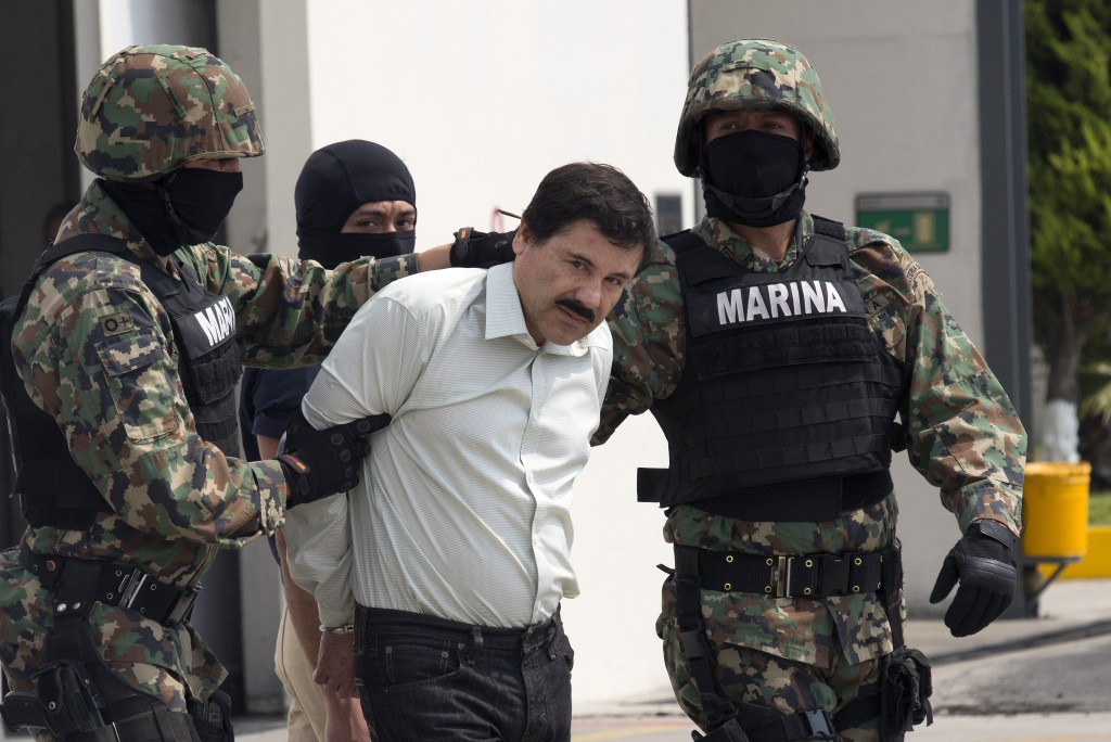 "Drug trafficker Joaquin ""El Chapo"" Guzman is escorted to a helicopter by Mexican security forces on Feb. 22. On Sunday, new details emerged about the Mexican-U.S. effort that led to Guzman's apprehension. Credit: Susana Gonzalez/Bloomberg via Getty Images"